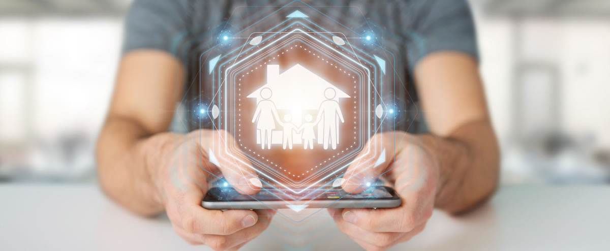man holding a hologram graphic of a house